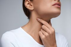 Sore Throat. Closeup Beautiful Woman Hands And Neck. Throat Pain Royalty Free Stock Photos