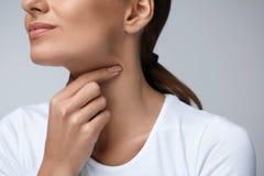 Sore Throat. Closeup Beautiful Woman Hands And Neck. Throat Pain Stock Photos