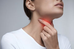Sore Throat. Closeup Beautiful Woman Hands And Neck. Throat Pain Stock Images