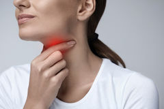Sore Throat. Closeup Beautiful Woman Hands And Neck. Throat Pain Royalty Free Stock Photography