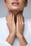 Sore Throat. Closeup Beautiful Woman Hands And Neck. Throat Pain Royalty Free Stock Images