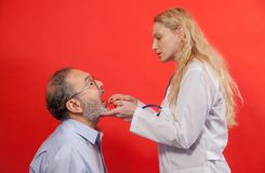 Sore Throat General Practitioner. Adult male with female doctor, medical examination of sore throat Royalty Free Stock Photo