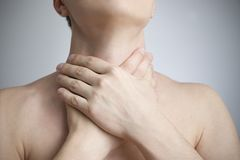 Sore throat of a men. Touching the neck Royalty Free Stock Image