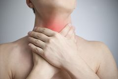 Sore throat of a men. Touching the neck. Red dot Stock Photography