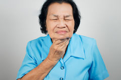 Sore throat old woman. Sore throat woman on white background stock photos