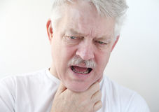 Sore throat in older man stock images