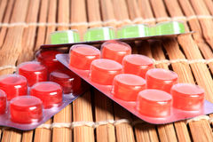 Sore throat pills Royalty Free Stock Images