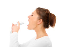 Sore throat spray. A portrait of a young woman with sore throat spray over white background Royalty Free Stock Photos