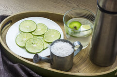 Sore Throat Therapy. Traditional sore throat therapy - salt,lemon,warm water and lemonade royalty free stock images