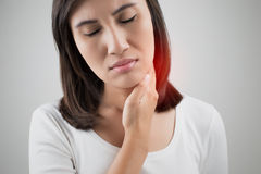 Sore throat woman. Lymph node at neck royalty free stock images