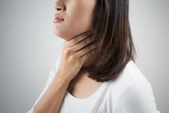 Sore throat woman. On white background royalty free stock photos