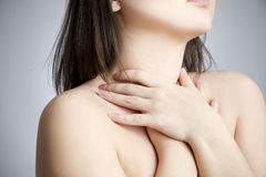 Sore throat of a women. Touching the neck Royalty Free Stock Photography