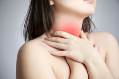 Sore throat of a women. Touching the neck stock images
