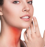 Sore throat of a women. Sore throat of a woman. Touching the neck. Isolated on white background stock photo