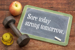 Sore today, strong tomorrow fitnes concept Stock Photography