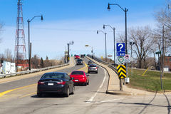 Sorel-Tracy bridge road. Sorel-Tracy, Сanada- April 20, 2016: Sorel-Tracy old bridge road view from St-Joseph town at spring sunny day afternoon stock photography