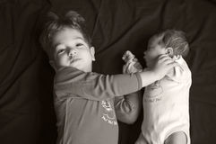 Sorella del bambino e del fratello maggiore Fotografia Stock