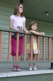 Sorelle sulla veranda Fotografia Stock Libera da Diritti