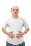 Soreness from malnutrition. abdominal distention. Elderly people suffering from indigestion or constipation Stock Photos