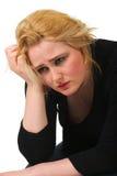 Sorgen machende blonde Frau Stockfoto