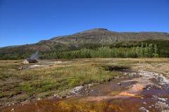 Sorgenti di acqua calda nell'area dorata di Geysir e del cerchio Immagine Stock