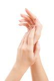Sorgfalt für Frauenhände Lizenzfreie Stockfotos