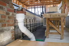 Sorghum Cook House. This is the fifth stage of the molasses making process. The raw juice is cooked here. As waste cooks to the top of the liquid, it is scooped stock photo