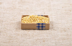 Sorghum on linen. Colorful and crisp image of sorghum on linen Stock Photography