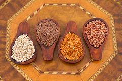 Sorghum, millet and flaxseed in spoon.  royalty free stock images