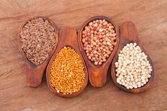 Sorghum, millet and flaxseed in spoon.  stock photography