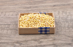Sorghum on wood Royalty Free Stock Photos