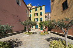 Sori, small square, Italy. Typical small square with stone paving and olive trees in Sori, Liguria, Italy Royalty Free Stock Photography