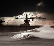 Sormy waves. Big waves during a storm in the Portuguese coast - north side of Leixoes harbor - Porto (enhanced sky Stock Image