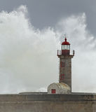 Sormy waves splash over old lighthouse Royalty Free Stock Image