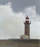 Sormy waves splash over old lighthouse Royalty Free Stock Image