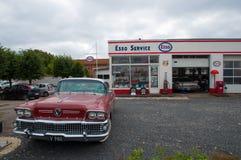 Old vintage car in front of a vintage petrol station and workshop. Soro Denmark - September 16. 2017: old vintage car in front of a vintage petrol station and stock photos