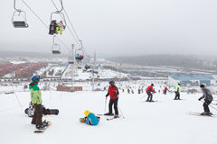 Sorochany Ski resorts with skiing people. KUROVO, DMITROVSKY DISTRICT, RUSSIA – CIRCA JANUARY 2012: Ski resorts Sorochany and skiing people in Moscow Region on royalty free stock image
