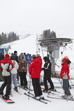 Sorochany Ski resorts with waiting queue people. KUROVO, DMITROVSKY DISTRICT, RUSSIA – CIRCA JANUARY 2012: Ski resorts Sorochany and waiting queue people in Stock Images