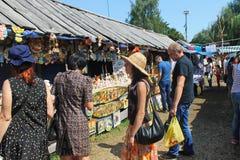 Sorochintsy Fair in Velyki Sorochyntsi, Ukraine. Velyki Sorochyntsi -August 20, 2016: Unidentified people walking on the Sorochintsy Fair in Velyki Sorochyntsi Stock Photos