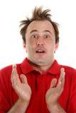 sorprenden al hombre en una camisa roja muy Imágenes de archivo libres de regalías