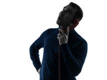 Sorpresa dell'uomo sul ritratto della siluetta del telefono Immagine Stock
