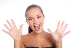 Sorpresa feliz para la muchacha adolescente con sonrisa hermosa Imagen de archivo libre de regalías