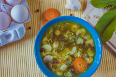 Sorrel green russian soup in the blue bowl Royalty Free Stock Photos