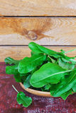 Sorrel leaves. Fresh sorrel leaves on a plate on the old wooden background.. health and diet food Stock Photography