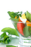 Sorrel salad and tomatoes with egg. Sorrel salad with eggs and tomatoes and herbs Royalty Free Stock Images
