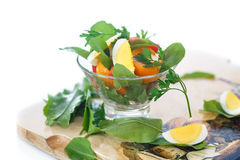 Sorrel salad and tomatoes with egg. Sorrel salad with eggs and tomatoes and herbs Stock Photo