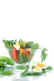 Sorrel salad and tomatoes with egg. Sorrel salad with eggs and tomatoes and herbs Royalty Free Stock Photography
