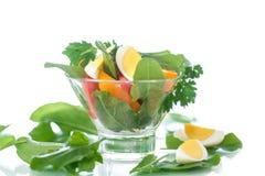 Sorrel salad and tomatoes with egg. Sorrel salad with eggs and tomatoes and herbs royalty free stock image