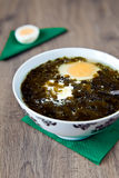Sorrel Soup. Close-up traditional spring meal - sorrel soup, serving with eggs and sour cream Stock Image