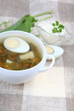Sorrel soup. In a white plate on the table Royalty Free Stock Photos